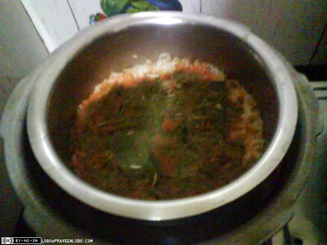 Boil rice(not completely) with tomato juice, coriander, mint etc.